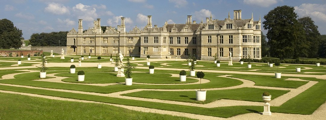 The grand west front of Kirby Hall, Northamptonshire, begun in the 1570s