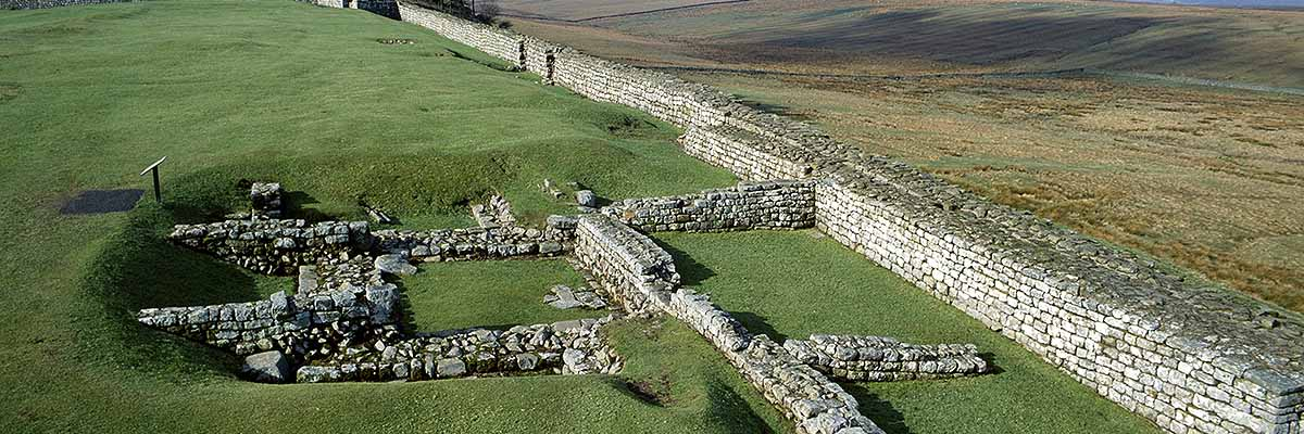View along the north wall of Housesteads Fort, showing the foundations of turret 36b partially overlain by later walls